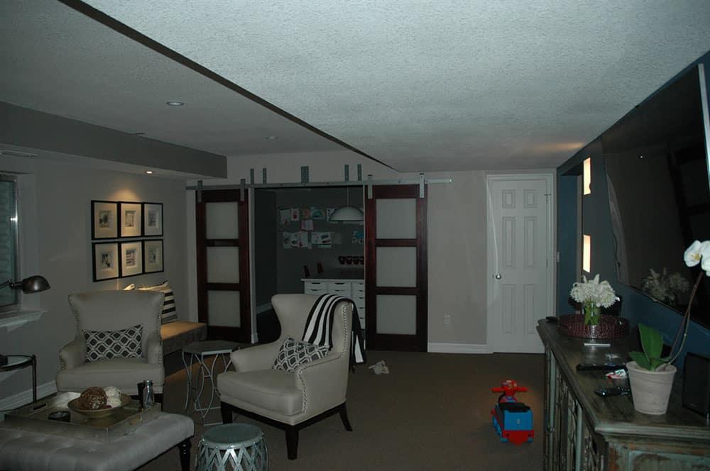 elegant basement sitting area and sliding doors