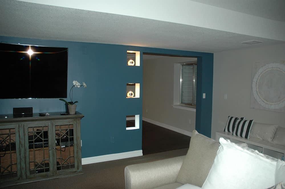 elegant basement tv area and doorway