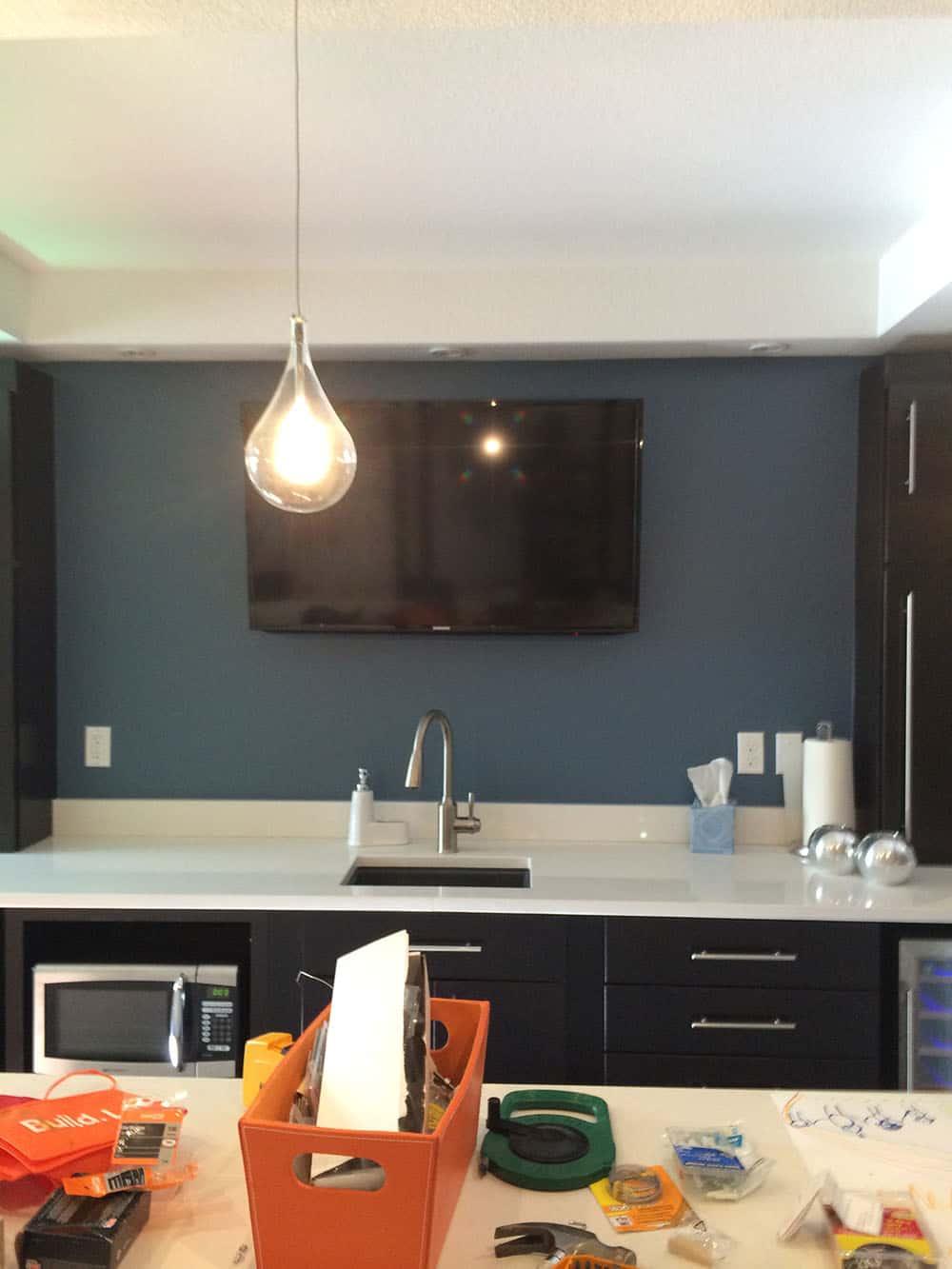 elegant basement tv above sink