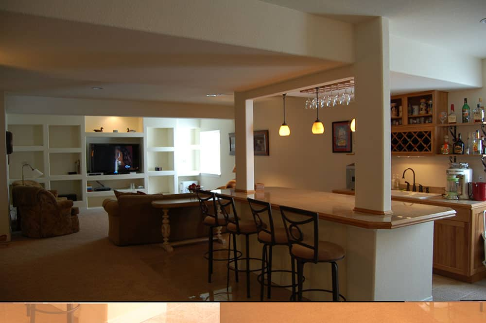 simple white basement bar and couches