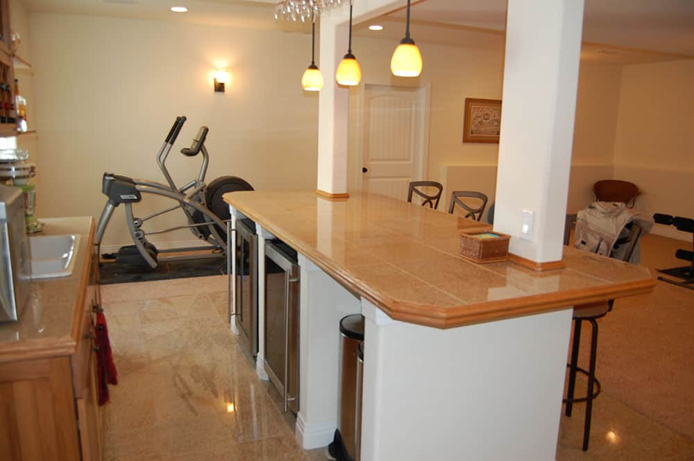 simple white basement exercise bikes and bar
