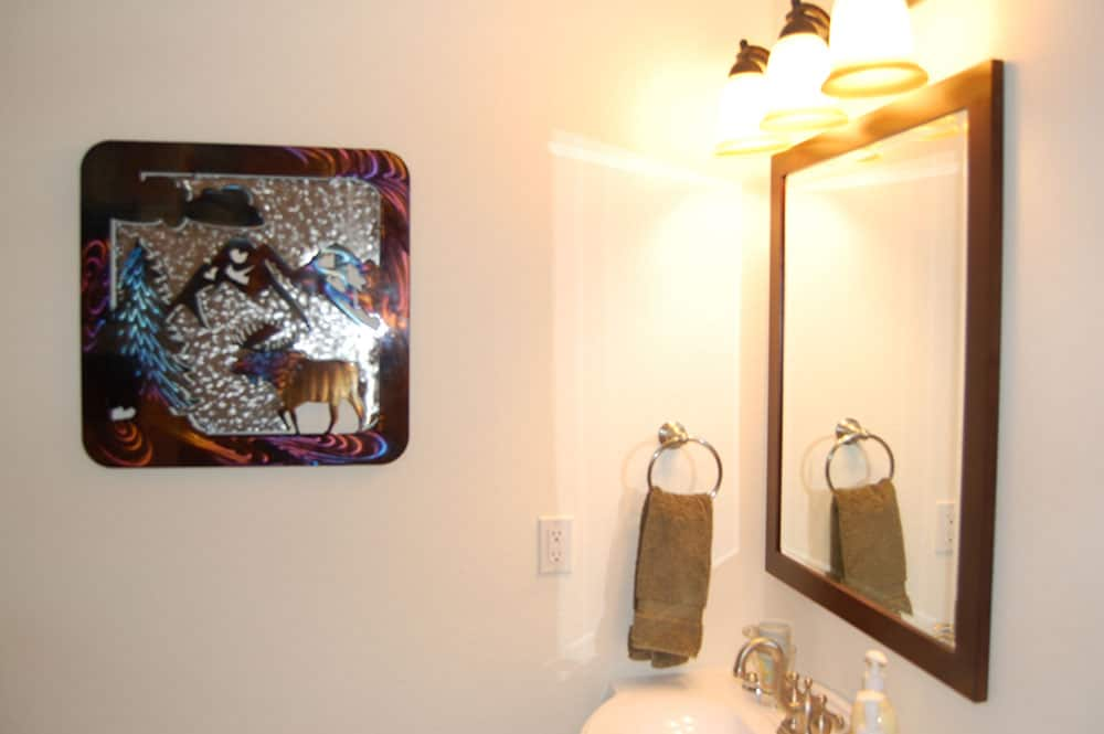 simple white basement bathroom mirror