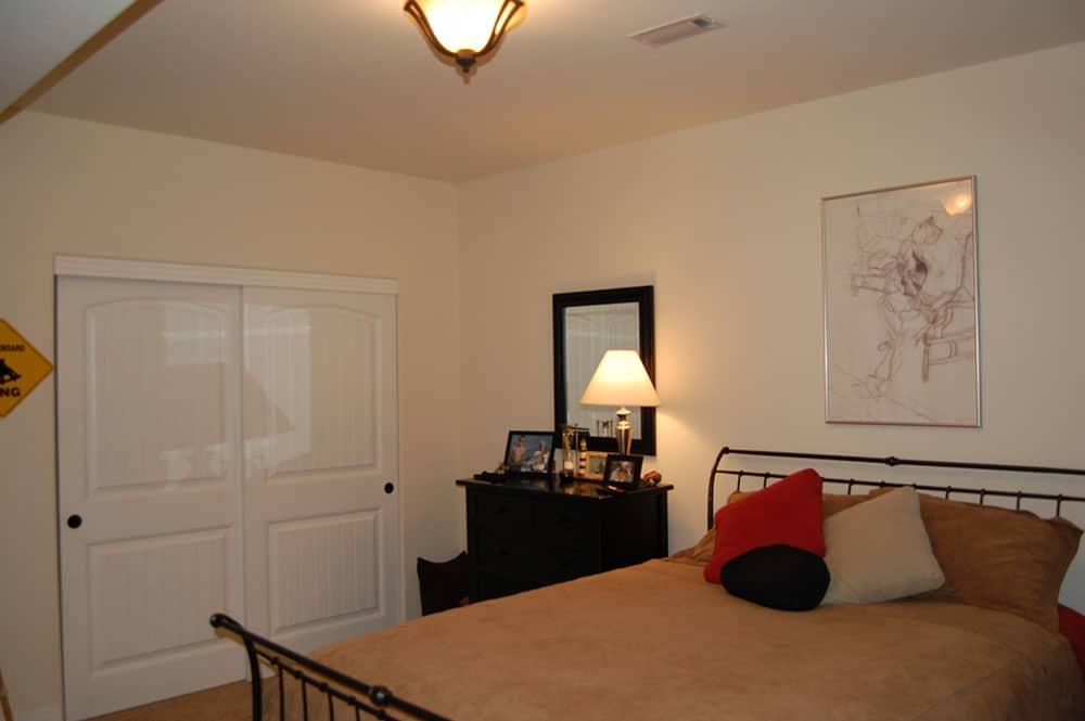 simple white basement adult bedroom