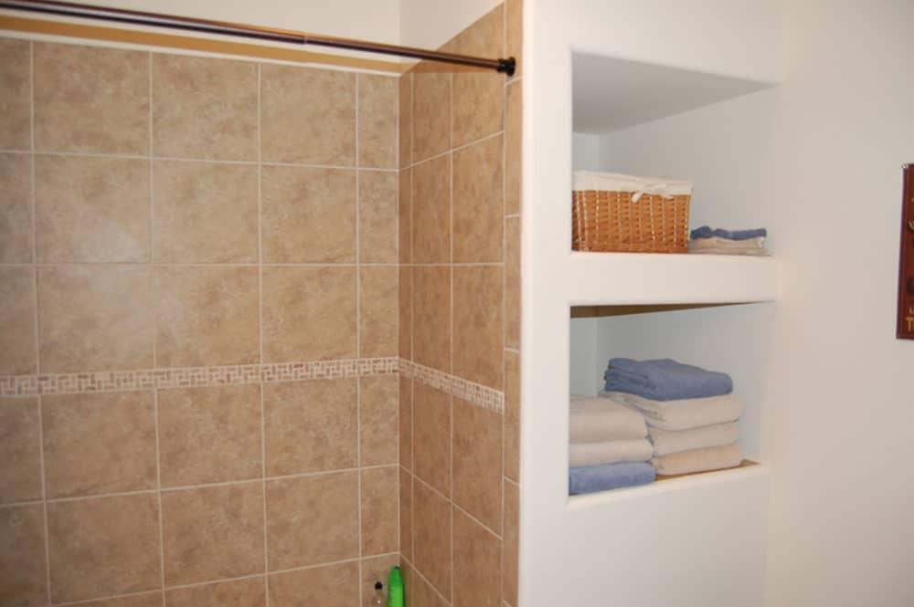 simple white basement shower