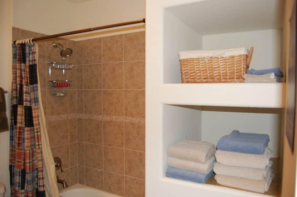 simple white basement bathroom