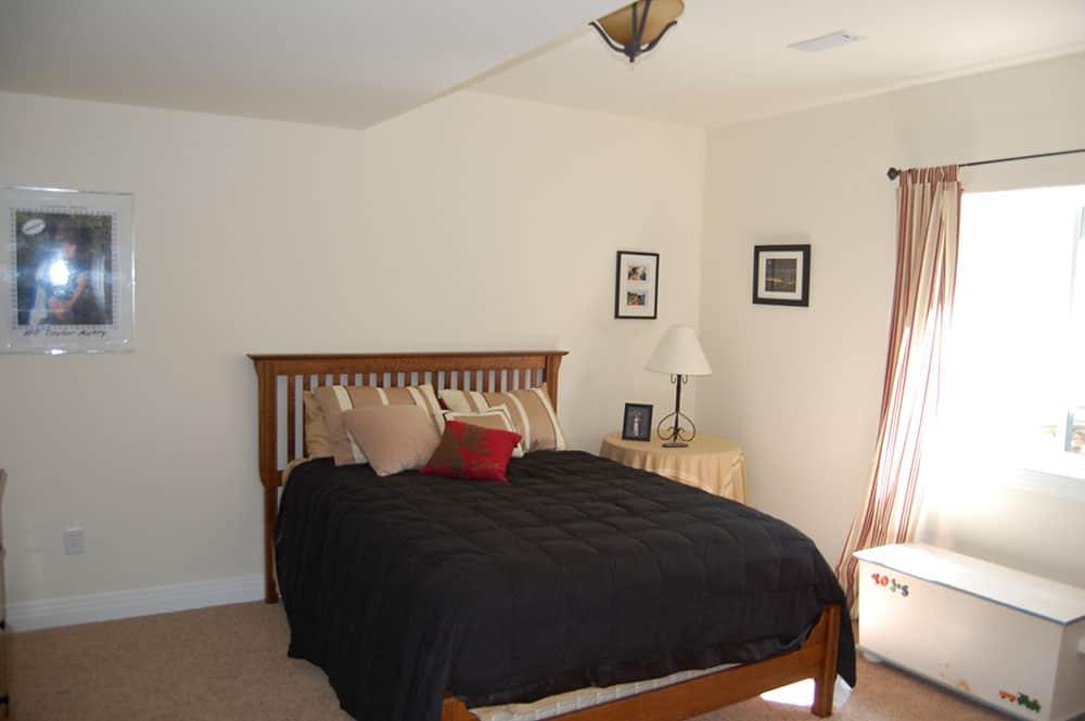 simple white basement bedroom
