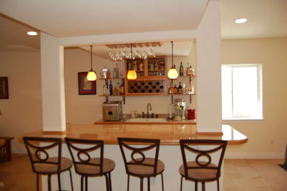 simple white basement bar