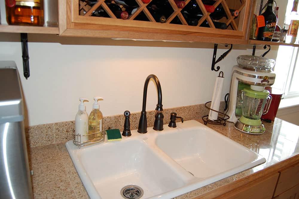 simple white basement sink