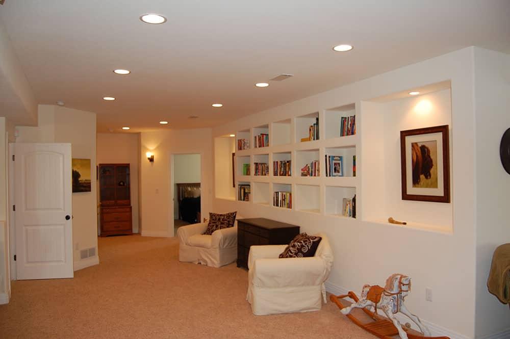 simple white basement reading area