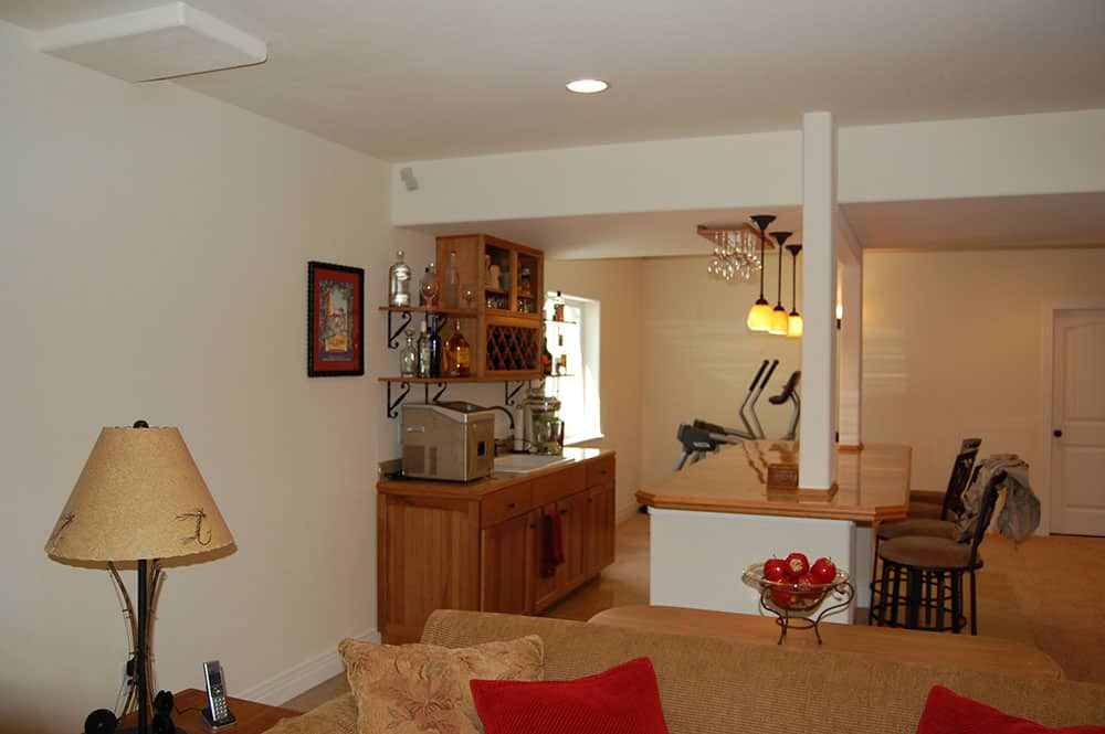 simple white basement bar and room