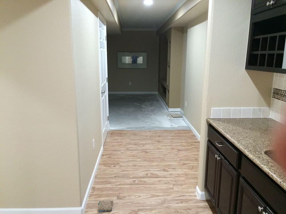 Wood floors in progress for finished basement