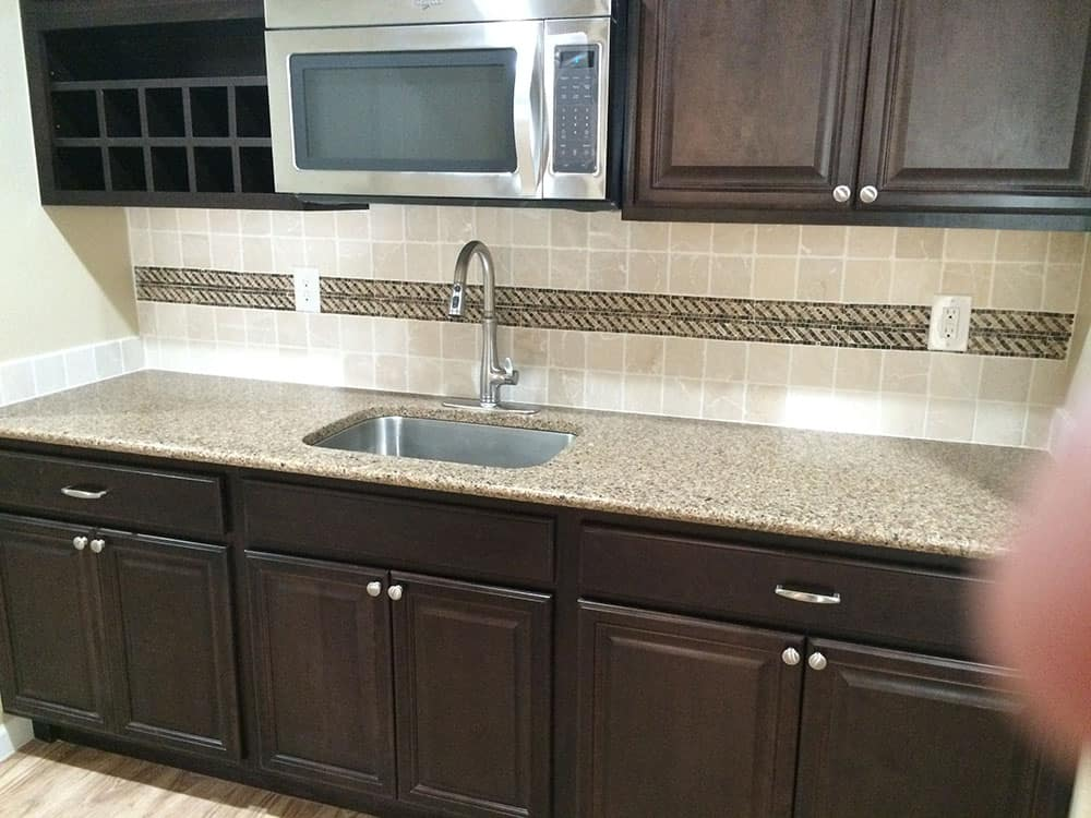 close up sink and microwave in basement