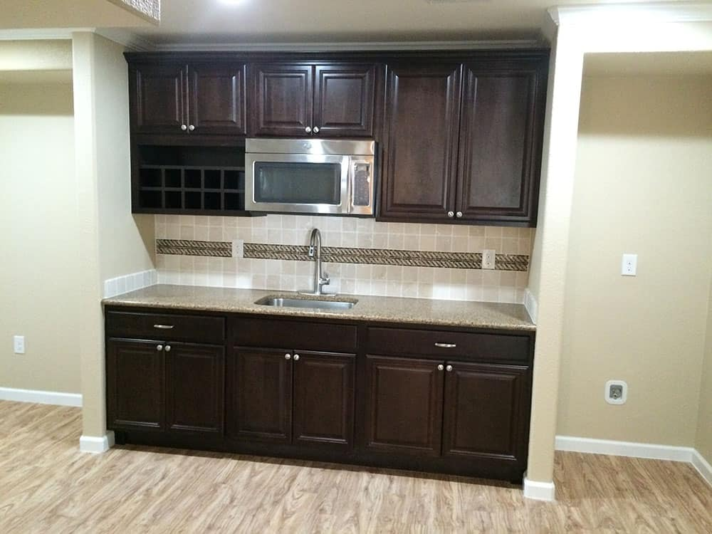 finished basement sink and microwave